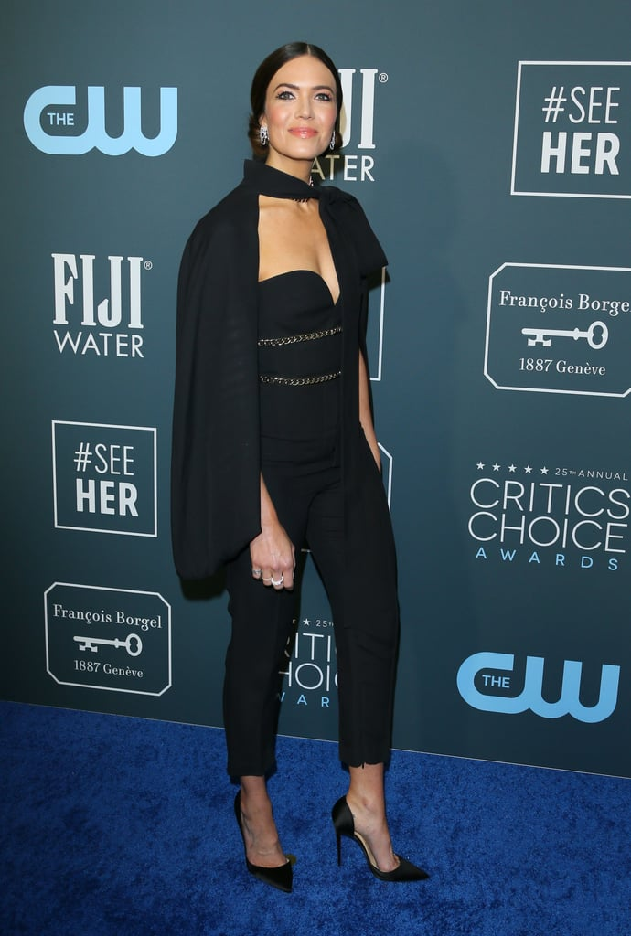 For Mandy Moore's next trick, she will pull high fashion out of a hat! The This Is Us-nominated actress made a sophisticated and stylish appearance on the Critics' Choice red carpet on Sunday night, wearing a strapless jumpsuit and matching cape. The magician at my fifth birthday party could never.  The sleek Elie Saab number features delicate metallic detailing across her midsection, perfectly tying in the sparkling Anita Ko jewlery on her neck, ears, and fingers. Mandy's stylist Cristina Ehrlich finished the look off with a pair of classic black Louboutin, a failsafe at any award show. Keep reading to see more of Mandy's outfit before she *poof* disappears for the night.       Related:                                                                                                           Billy Porter's Strapless Dress Has Quite the Surprise From Behind