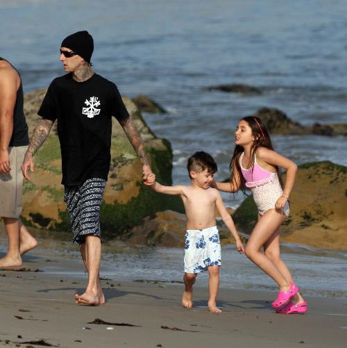 Down in Malibu, Travis Barker took his kids, Landon and Atiana out in the surf.