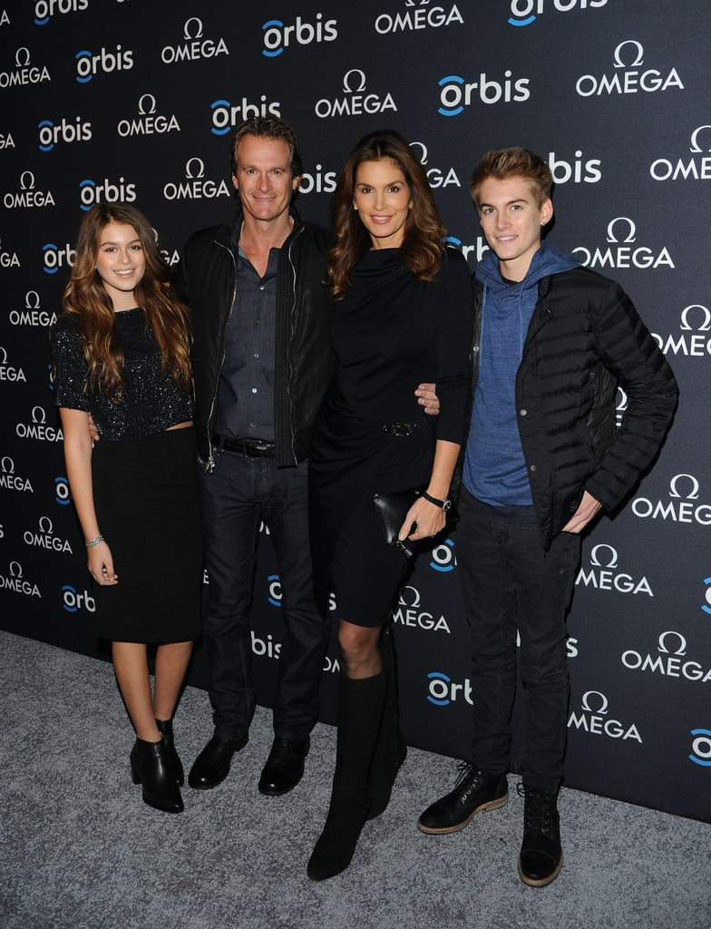We all know Cindy Crawford won in the looks department; her decades-long modeling career is proof of that. So it should come as no surprise that her kids also hit the genetic jackpot. Cindy and her hot husband, Rande Gerber, have two children, 15-year-old Presley and 13-year-old Kaia, and it's safe to say the duo inherited their parents' stunning features and gorgeous skin. Kaia already put her genes to work as a model for Young Versace in 2012, and both kids routinely show off their style on their joint Instagram account. Despite the whole family being in the public eye, it's rare that we see all four of them together at once. But at Thursday night's NYC screening of The Hospital in the Sky, they did just that. Cindy, Rande, Kaia, and Presley all posed for the cameras, and their collective gorgeousness was almost too much to handle.