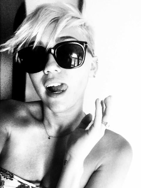 Miley Cyrus modeled a dark pair of shades.  Source: Twitter user MileyCyrus