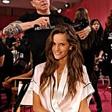 Izabel Goulart was all smiles while her stylist put the finishing touches on her look.