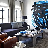 An oversize painting by Otto Zitko is the focal point of the upstairs family room.