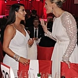Kim Kardashian chatted with Molly Sims at Elton John's party on Oscar night.