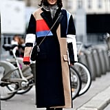 A colorblocked coat did all the work in this attendee's ensemble.