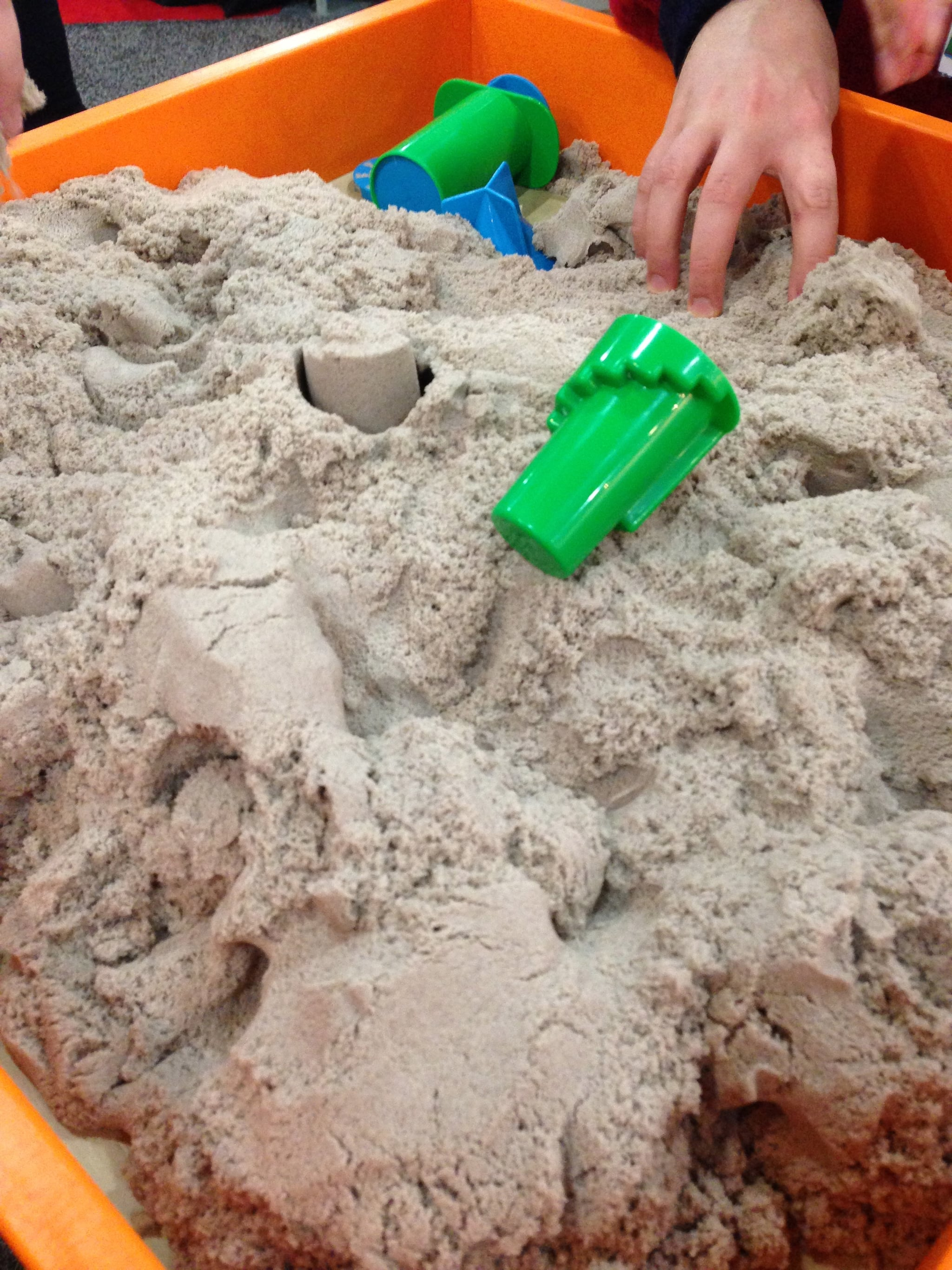 All the fun of the beach, minus the mess (and of course, the ocean) — you have to feel Kinetic Sand to believe it.