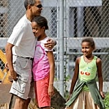 Barack embraced his eldest daughter before entering the Honolulu Zoo in December 2008.