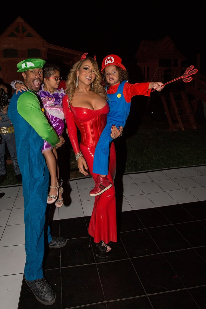Mariah Carey knows how to do Halloween right! On Saturday, the singer hosted her annual Halloween bash in LA, bringing out ex-husband Nick Cannon, their adorable twins, Moroccan and Monroe, and a bevy of stars, including Floyd Mayweather and rapper Master P. This year, Mariah opted for a tight red latex devil costume, which showed off her curves and an ample amount of cleavage, and Nick went as Luigi, but ultimately, it was her kids who ended up having the best costumes of the night. Monroe looked beyond precious as Rapunzel and Moroccan dressed as Mario from the Super Mario Bros. Last year, Mariah rented out a private Airbnb for her party and dressed up as a sexy witch, while her kids channelled Batman and Batgirl. If this is any indication of what's to come, we can't wait to see what they do on Oct. 31.