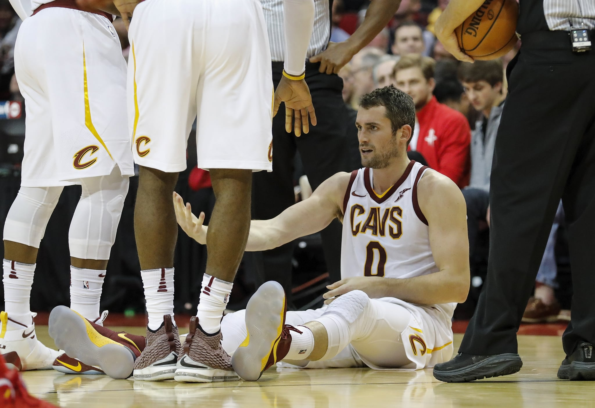 HOUSTON, TX - NOVEMBER 09:  Kevin Love #0 of the Cleveland Cavaliers is helped from the floor in the first half against the Houston Rockets at Toyota centre on November 09, 2017 in Houston, Texas.  NOTE TO USER: User expressly acknowledges and agrees that, by downloading and or using this photograph, User is consenting to the terms and conditions of the Getty Images licence Agreement.  (Photo by Tim Warner/Getty Images)