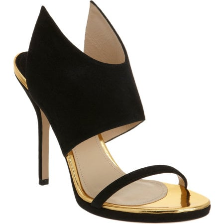 I instantly fell in love with these Paul Andrew Nya heels ($865), and it's pretty obvious why. The sharp ankle detail reminds me of wings and the mix of black and gold is undeniably sexy. All you need with these beauties is a little black dress and you're good to stun. — MN