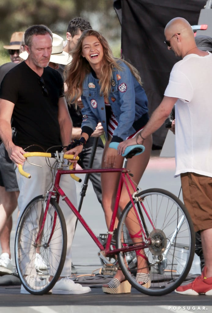 Gigi Hadid sported a sexy, striped one-piece swimsuit for a photo shoot at the beach in LA on Thursday. The model flashed a smile as she posed for pictures on a bike and showed off her superlong legs for photographers. Gigi has already done her fair share of swimwear shoots this Summer, both professionally and in her free time; she put her killer figure on display during pal Taylor Swift's Fourth of July party earlier this month — where the friends wore matching Solid & Striped numbers — and continues to steam up our phones with her bevy of bikini photos on Instagram.