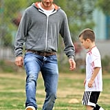 David Beckham playing soccer with Cruz.