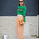 Tuck a Sweater Into a Pair of Wide-Leg Trousers