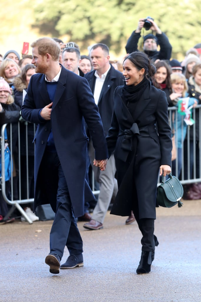 In January 2018, Meghan ditched royal protocol by wearing a jet-black outfit, which she accessorized with a green DeMellier handbag.