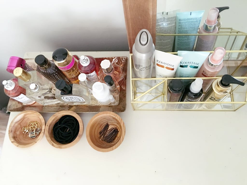 """Best beauty organization tips:   """"Keep a separate travel bag with duplicates of your favorite products. It makes packing super quick and there is something so calming about traveling and pulling out your favorite stuff.""""  """"If it's a pretty product, place it on a tray with apothecary jars and a candle to add some glamour to your vanity."""""""