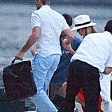 George Clooney helped Stacy Keibler onto his boat in Lake Como.