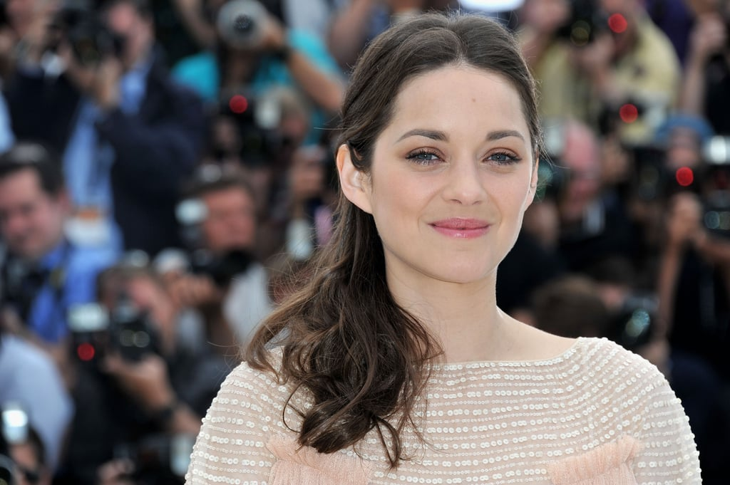 Marion Cotillard smiled on the red carpet at the press conference for Rust and Bone at the Cannes Film Festival.