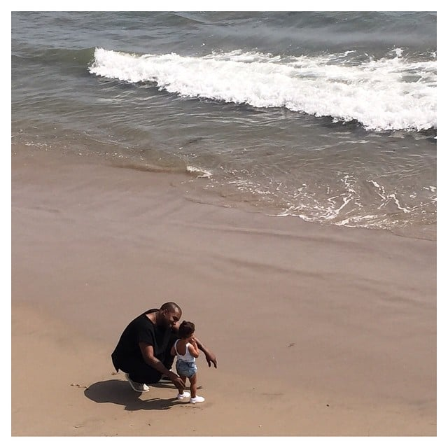 Kim shared a sweet picture of North and Kanye on the beach.