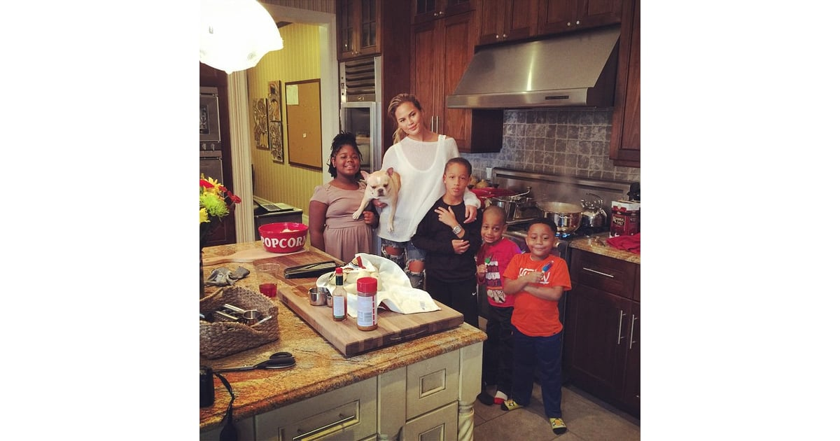 chrissy teigen hung out with family members in the kitchen