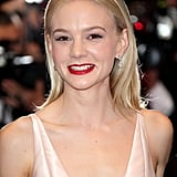 """Carey Mulligan glammed up the red carpet for the premiere of The Great Gatsby at the Cannes Film Festival. """"I've only once created a red lip with her, but I loved the idea of contrast with the pale pink dress,"""" makeup artist Georgie Eisdell said. To create the striking look, Eisdell used Nars Jungle Red Lipliner ($36) topped with the brand's Jungle Red Lipstick ($39). To give Carey's skin a little colour to balance the brightness of her lips, Eisdell used Blush in Sex Appeal ($45) for a hint of warm pink."""