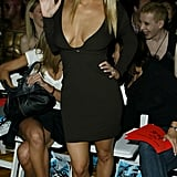 Jessica Simpson waved to cameras from the front row at House of Field in September 2003.