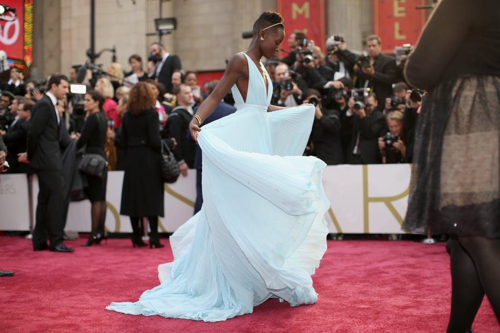 18 Pictures of Lupita Nyong'o Loving Life in Her Prada Dress