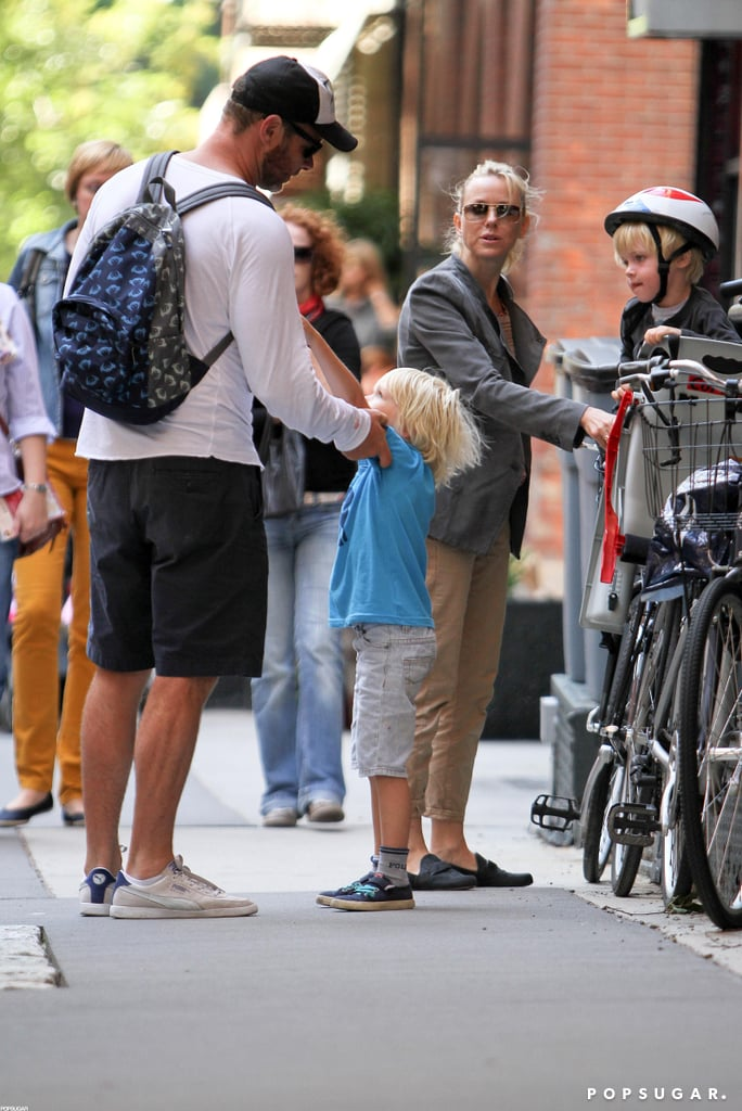 Liev Schreiber and Naomi Watts put helmets on their boys for a bike ride around the Big Apple.