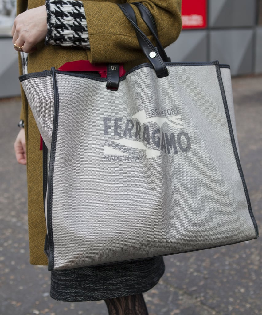 A Ferragamo carryall holds all of this Fashion Week attendee's necessities in one chic spot.