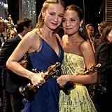 Backstage, Brie and best supporting actress winner Alicia Vikander posed for photos with their awards.