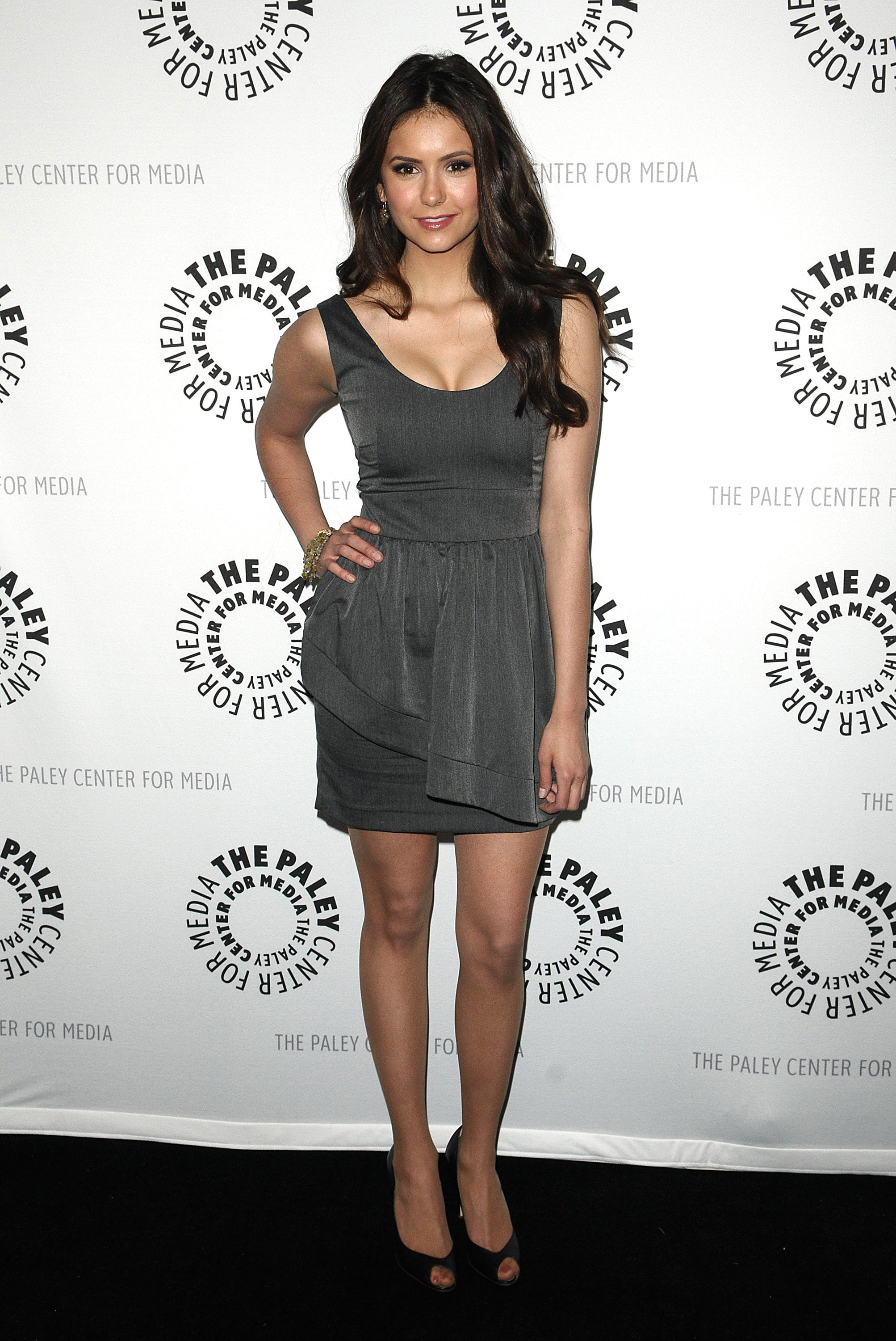 Nina is able to easily transition into supersophisticated looks. Case in point: this chic gray sheath styled with peep-toe pumps she wore to Paley Fest in 2010.