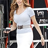 Sofia Vergara wore a white skirt and light blue top on set.