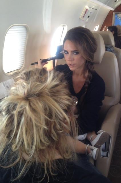 Victoria tweeted a photo of her getting ready on the plane ride to Vancouver with Harper on her lap. Source: Twitter user Victoria Beckham