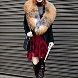 Jane Aldridge went punk-meets-luxe in a fur collar and school-girl plaid.