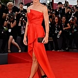 For the Gravity premiere, which was simultaneously the opening ceremony of the 70th annual Venice International Film Festival, Sandra Bullock wowed in a J. Mendel siren red silk strapless bustier dress and Roger Vivier ankle-strap sandals.