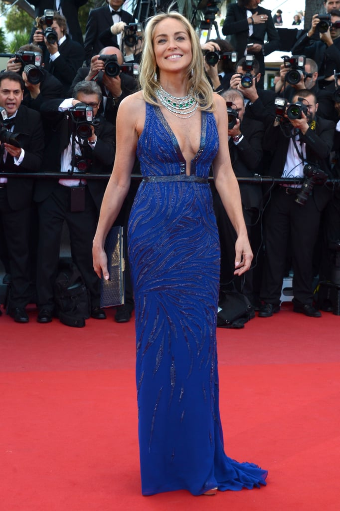 Sharon Stone was radiant in a bright blue Roberto Cavalli gown and equally vibrant jewels at the Behind the Candelabra premiere.