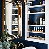 The modern blue color makes for a gorgeous backdrop when matched with gold fixtures. The deep sink adds a luxurious touch, and of course, they left room for valuable built-in storage.