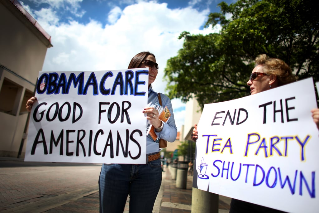 Women showed their support for the Affordable Care Act during a rally at Miami's Stephen P. Clark Government Center.