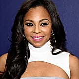 Ashanti was spotted in New York City for the View From the Top jazz event. She wore her hair down in smooth curls, but it was her pop of bright pink on her lips that had our heads turning.