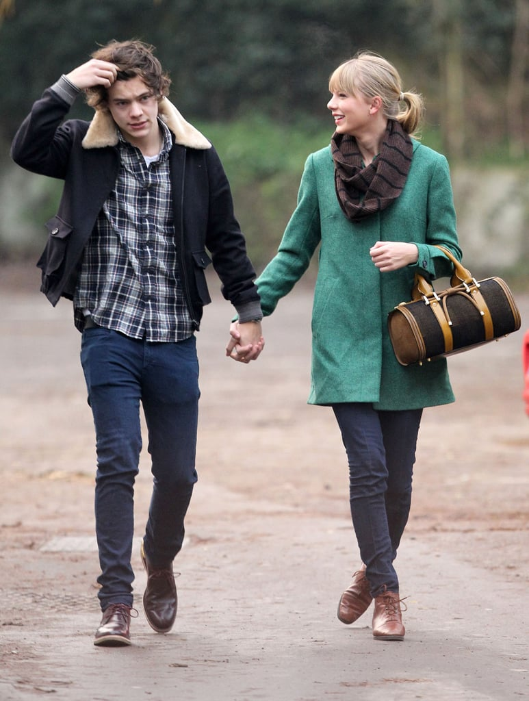 Taylor Swift and Harry Styles laughed in England.