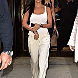 Elevating a white tank with trousers, not jeans.