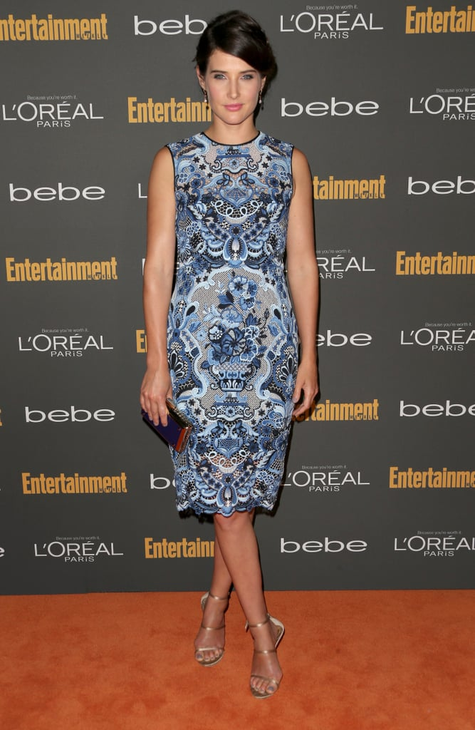 In a sea of black, Cobie Smulders popped in her blue printed sleeveless dress and metallic sandals at the Entertainment Weekly pre-Emmys party in LA.