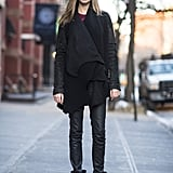 Sure, it's simple, but this all-black look scores points with a little leather and a pair of tough-girl boots.  Source: Le 21ème | Adam Katz Sinding