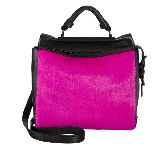 """Is a """"pursehorse"""" a thing? If it is, I am one. This 3.1 Phillip Lim Ryder satchel ($1,095) in fuchsia ponyhair and black leather is the latest object of my affection. The color is intense, but the details and hardware are sleek and streamlined, making it the kind of gift any fashion-lover worth her mettle would gasp upon finding under the Christmas tree. — Lindsay Miller, entertainment editor"""