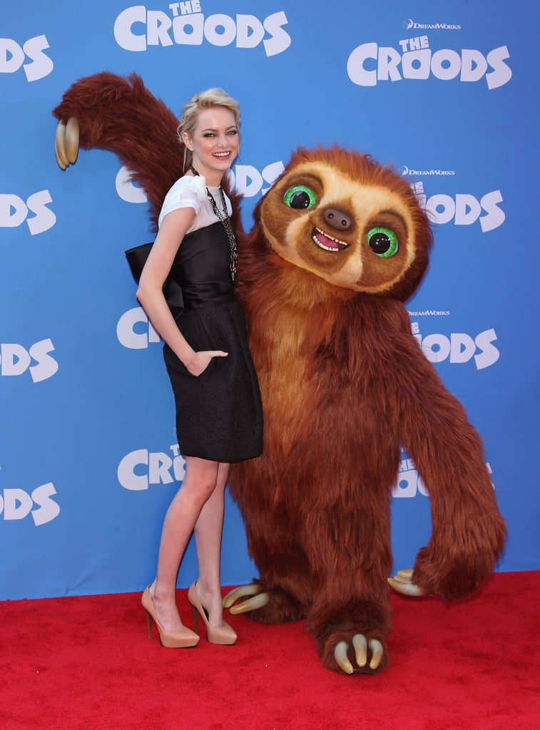 Emma Stone posed with a creature on the red carpet while promoting her animated film The Croods in NYC in March 2013.