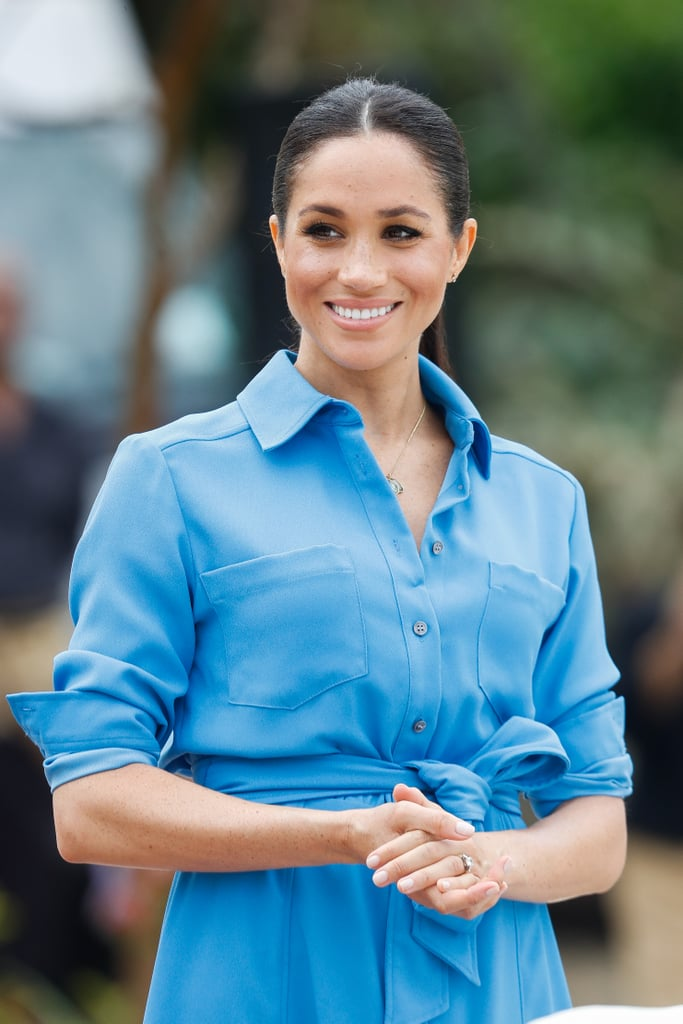 If you thought Meghan Markle was done serving looks on her royal tour with Prince Harry, think again. After looking polished in a dreamy Martin Grant dress during the second day of her visit in Tonga, the Duchess of Sussex switched up her look when she attended the unveiling of The Queen's Commonwealth Canopy at Tupou College on Friday. Meghan stepped out in a sky blue Veronica Beard shirtdress, which she matched perfectly with a pair of blue suede heels.  Of course, this isn't the first time Meghan has wowed us in blue during the tour. The royal donned a navy Stella McCartney cape dress in Sydney, a sleeveless navy dress by Australian designer Dion Lee in Melbourne, and a gorgeous bright blue Safiya gown for a state dinner in Fiji. If we had to take a wild guess, we'd say blue might just be Meghan's color.       Related:                                                                                                           People Think Meghan Markle's Rings Reveal Her Due Date, and TBH, It's a Solid Theory