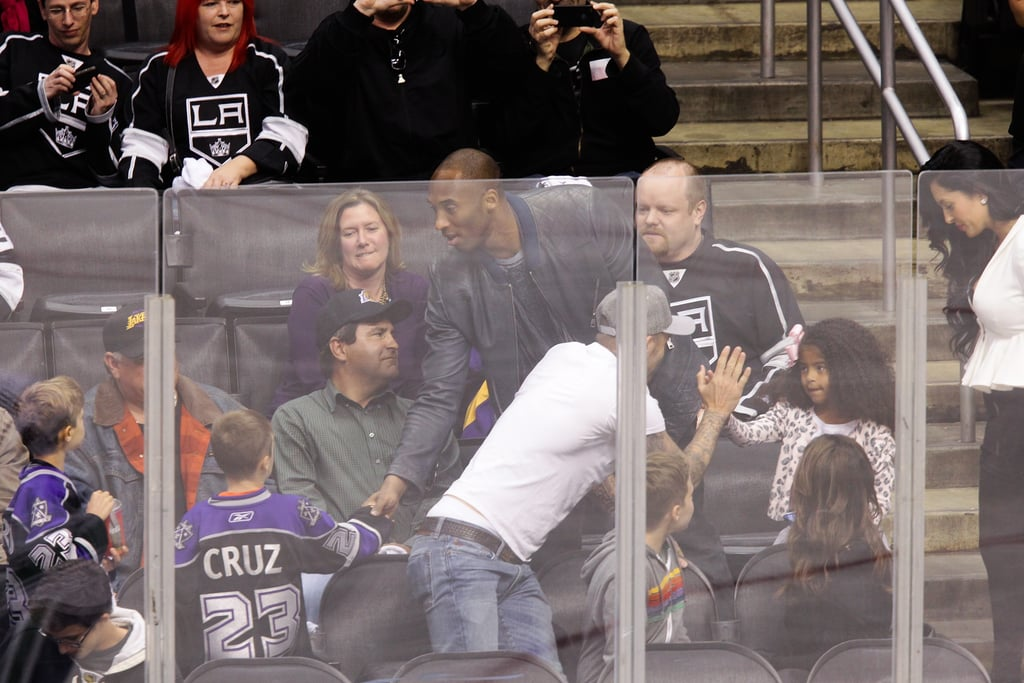 David Beckham greeted Kobe Bryant's family at the playoff hockey game in LA.
