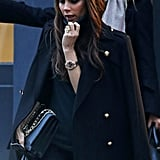 Fashion designer Victoria Beckham wore a turtleneck while walking in London.