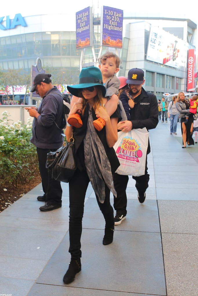 Nicole Richie and Joel Madden carried their kids Harlow and Sparrow to the Yo Gabba Gabba show in LA.