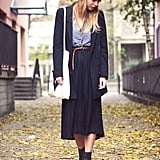 Adding cozy edge (literally), this street styler shifts the focus of a pleated skirt from femme to street cool with a knit beanie, buckled boots, and borrowed-from-the-boys outerwear.    Photo courtesy of Lookbook.nu