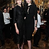 Karlie Kloss looked lovely in a black lace dress with matching pumps while posing with L'Wren Scott at the designer's cocktail party during London Fashion Week.