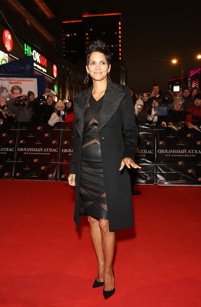 Halle Berry put on a coat after posing for pictures.